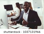 a black guy poses on the camera ... | Shutterstock . vector #1037131966