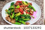 fried meat and chinese kale... | Shutterstock . vector #1037133292