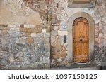 old door in ancient medieval...   Shutterstock . vector #1037150125