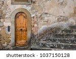 old door in ancient medieval...   Shutterstock . vector #1037150128