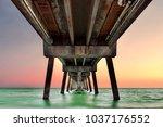 under pier at sunset | Shutterstock . vector #1037176552