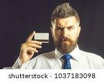 businessman holding credit card....