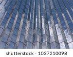 facade of a modern glss fronted ... | Shutterstock . vector #1037210098