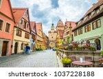 beautiful streets in rothenburg ... | Shutterstock . vector #1037228188