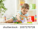 toddler boy playing with toys... | Shutterstock . vector #1037270728