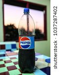 Small photo of LAMPHAYA,NAKHONPATHOM/THAILAND - 2018 March 16: Pepsi is a carbonated soft drink produced and manufactured by PepsiCo Inc. on Colorful background on Merch 16 , 2018 in Thailand.