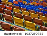 Small photo of Empty bleacher seats in gymnasium