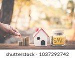female hand holding coins on... | Shutterstock . vector #1037292742