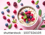 oatmeal cereal with milk and... | Shutterstock . vector #1037326105