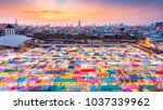 """Small photo of Colorful food stalls at """"Ta lad Rod Fai"""" Night Market in Bangkok. Bangkok is the capital and most populous city of Thailand."""