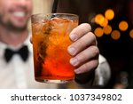 a man is holdig a glass and... | Shutterstock . vector #1037349802