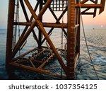 an oil and gas jacket platform... | Shutterstock . vector #1037354125