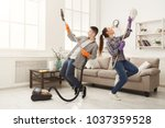 young couple cleaning home ... | Shutterstock . vector #1037359528