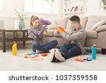 young couple spring cleaning... | Shutterstock . vector #1037359558