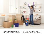 new home cleaning. young woman... | Shutterstock . vector #1037359768