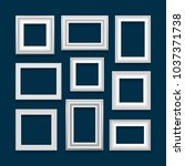set of white picture frames on... | Shutterstock . vector #1037371738