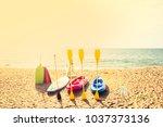 kayaks on sand beach | Shutterstock . vector #1037373136