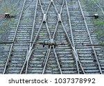 crossing the railway tracks in... | Shutterstock . vector #1037378992