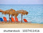 sunbeads and sunshade on the... | Shutterstock . vector #1037411416
