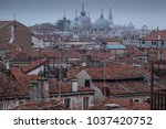 Small photo of Venice Italy, February 2018. Bird's eye view of the red tiled roofs of Venice, taken from the viewing platform at the top of the T Fondaco dei Tedeschi shopping centre near the Rialto Bridge.