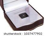 genuine diamond in opened brown ... | Shutterstock . vector #1037477902