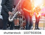 Small photo of World Jazz festival. Saxophone, music instrument played by saxophonist player and band musicians on stage in fest.