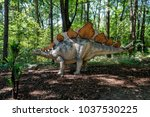 Big model of prehistoric dinosaur stegosaurus in nature. Realistic scenery.