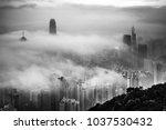 hong kong in misty season | Shutterstock . vector #1037530432