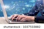 businessman typing on laptop... | Shutterstock . vector #1037533882