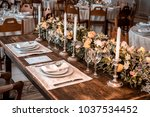 wooden table with white plates  ... | Shutterstock . vector #1037534452