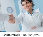 smiling female doctor greeting... | Shutterstock . vector #1037540998