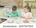 cute children decorate cookies...   Shutterstock . vector #1037547565