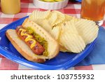 A Grilled Hot Dog And Potato...