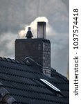 chimney of a house with smoke | Shutterstock . vector #1037574418
