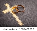 wedding rings on the bible | Shutterstock . vector #1037602852