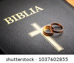 wedding rings on the bible | Shutterstock . vector #1037602855