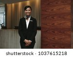 portrait of happy female hotel... | Shutterstock . vector #1037615218