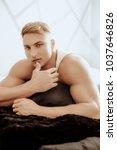young sexy muscular man   Shutterstock . vector #1037646826