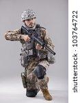 kneeling soldier with machine... | Shutterstock . vector #103764722