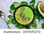 green smoothie bowl on a light... | Shutterstock . vector #1037651272