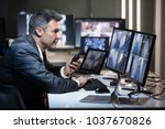 businessman talking on walkie... | Shutterstock . vector #1037670826