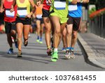 group of young runners a few... | Shutterstock . vector #1037681455