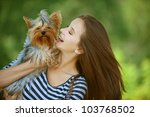 Stock photo young beautiful woman with yorkshire terrier against green of summer park 103768502