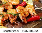 grilled shrimp skewers. seafood ... | Shutterstock . vector #1037688355