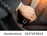 driver in business suit fastens ... | Shutterstock . vector #1037693815