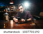 man sitting at bar counter and... | Shutterstock . vector #1037701192