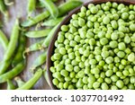 peeled green peas in a plate on ... | Shutterstock . vector #1037701492
