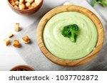 cream soup of broccoli on a... | Shutterstock . vector #1037702872