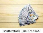 a lot of blue dollars heap on... | Shutterstock . vector #1037714566