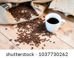 cup of coffee and coffee beans... | Shutterstock . vector #1037730262